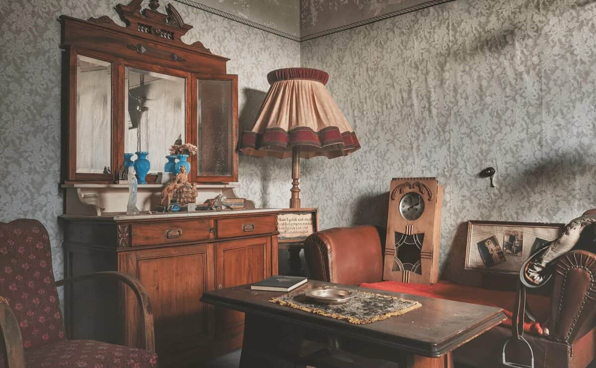 10 Tips for Cleaning a House You Have Inherited. Worn out wallpaper and genuine vintage wooden furniture