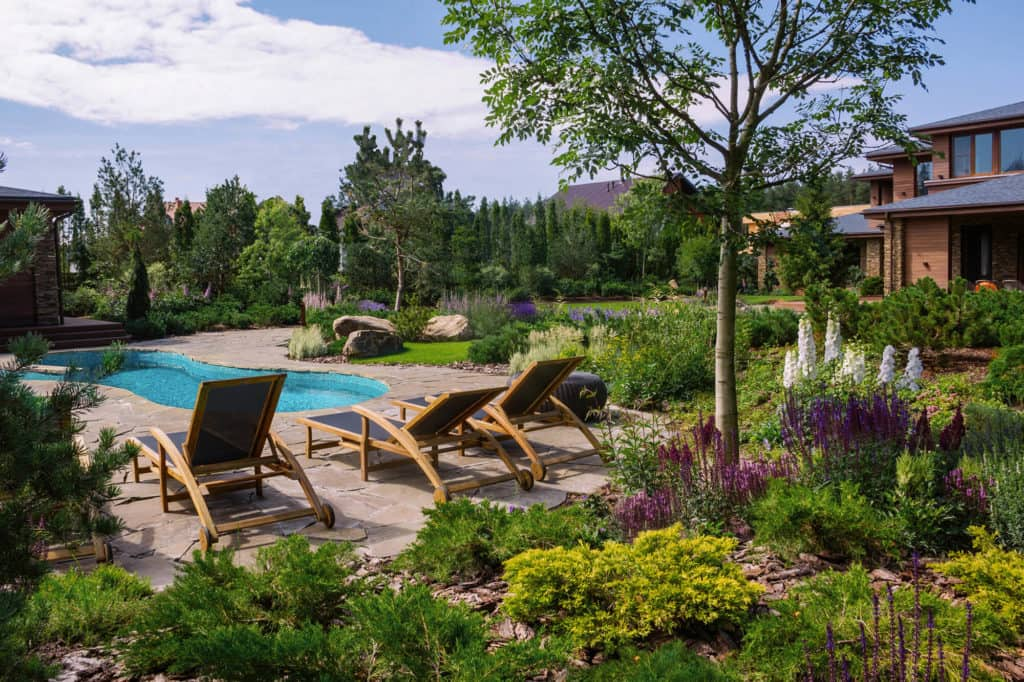 How to Divide Your Garden into Different Zones. Peculiarly and skillfully designed backyard at the village house near Saint-Petersburg, Russia