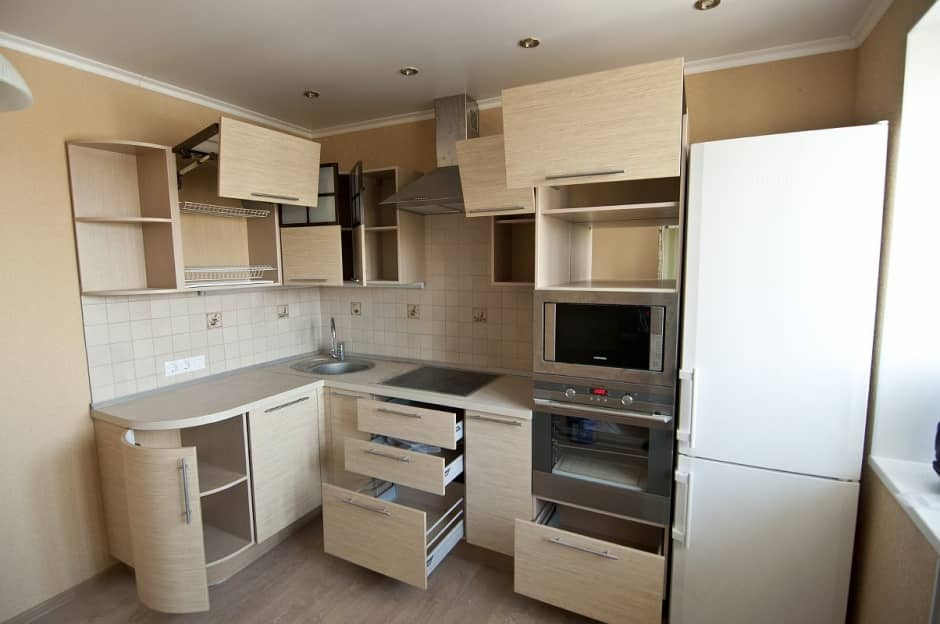 How to Remodel Your Kitchen In a Single Weekend. Functional kitchen set with pastel light wooden facades