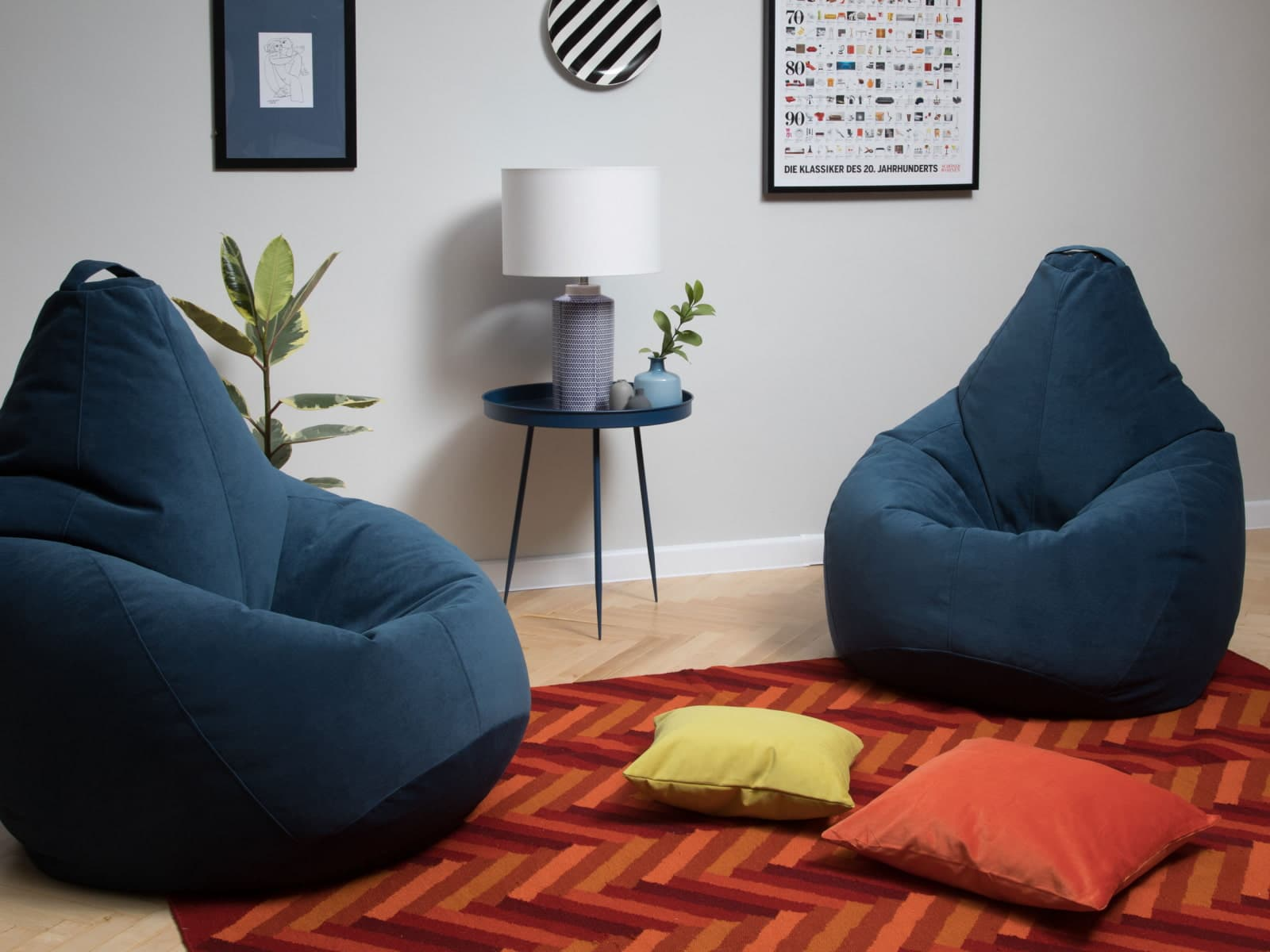 Blue bean bag chairs, red carpet and pictures for wall decoration