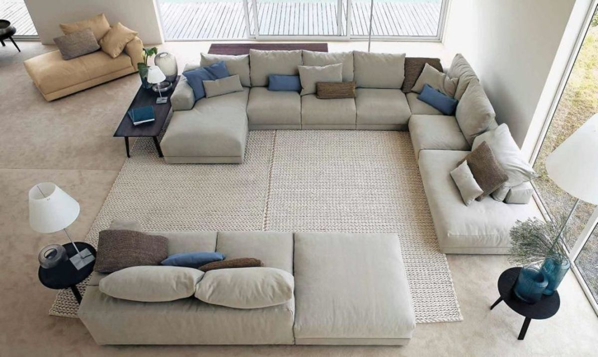 15 Simple Changes That Can Make Your Living Room Much Cozier. Large living with large angular sofa with many pillows