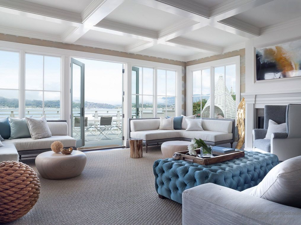 15 Simple Changes That Can Make Your Living Room Much Cozier. Quilted blue ottoman in the great white colored space with coffered ceiling and full if natural light