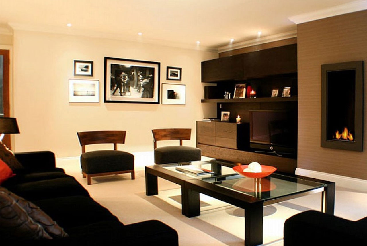 Japanese styled living room with dark wooden furniture and glass table