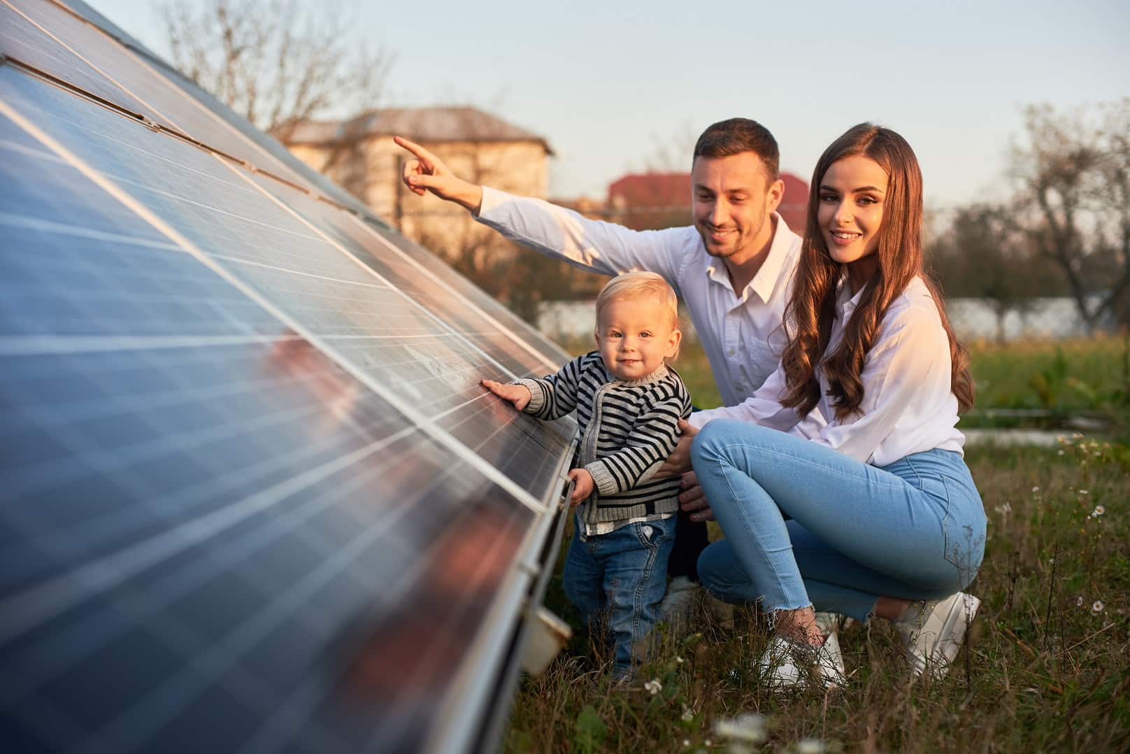 How To Pick The Right Solar System For Your Home. Happy family which is energy secured and ecolological with solar energy