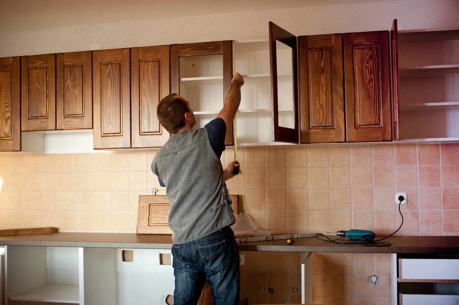 Top Tips to Follow When Remodeling Your Kitchen. Measuring the top cabinets by the pro