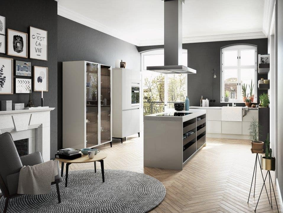 Urban Style Interior Design: The Essence of Big City at Home. Open layout kitchen with light wooden laminate and gray color palette