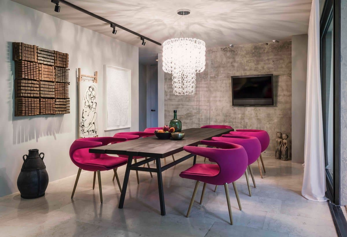 Urban Style Interior Design: The Essence of Big City at Home. Crimson designer chairs around the long black wooden table