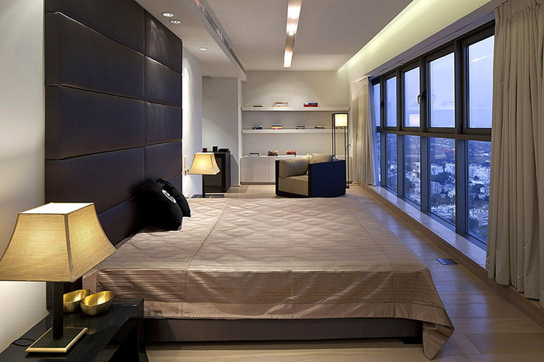 Large platform bed and panoramic window for galley bedroom with dark quilted soft headboard