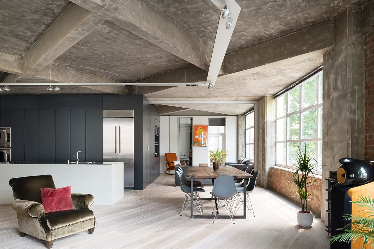 Exposed ceiling beams and upscale decorated interior with combination of colors, textures and materials