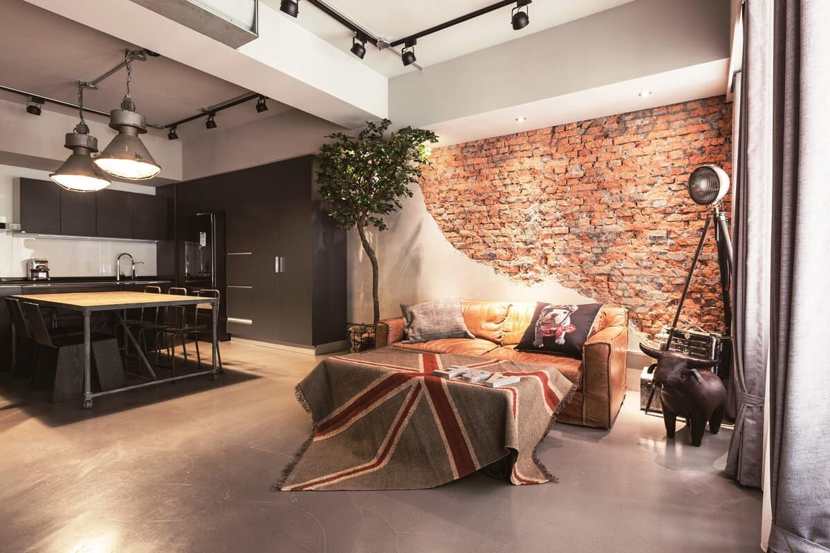 Unusual half-finished-half-brickwork cladded accent wall for creative open layout bedroom with light zoning