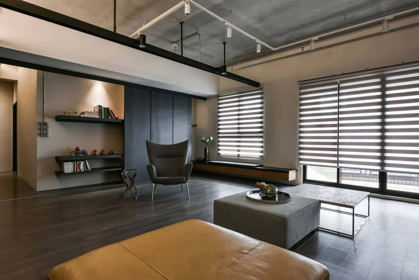 Classy roller Roman shades and concrete ceiling in the large-scale apartment