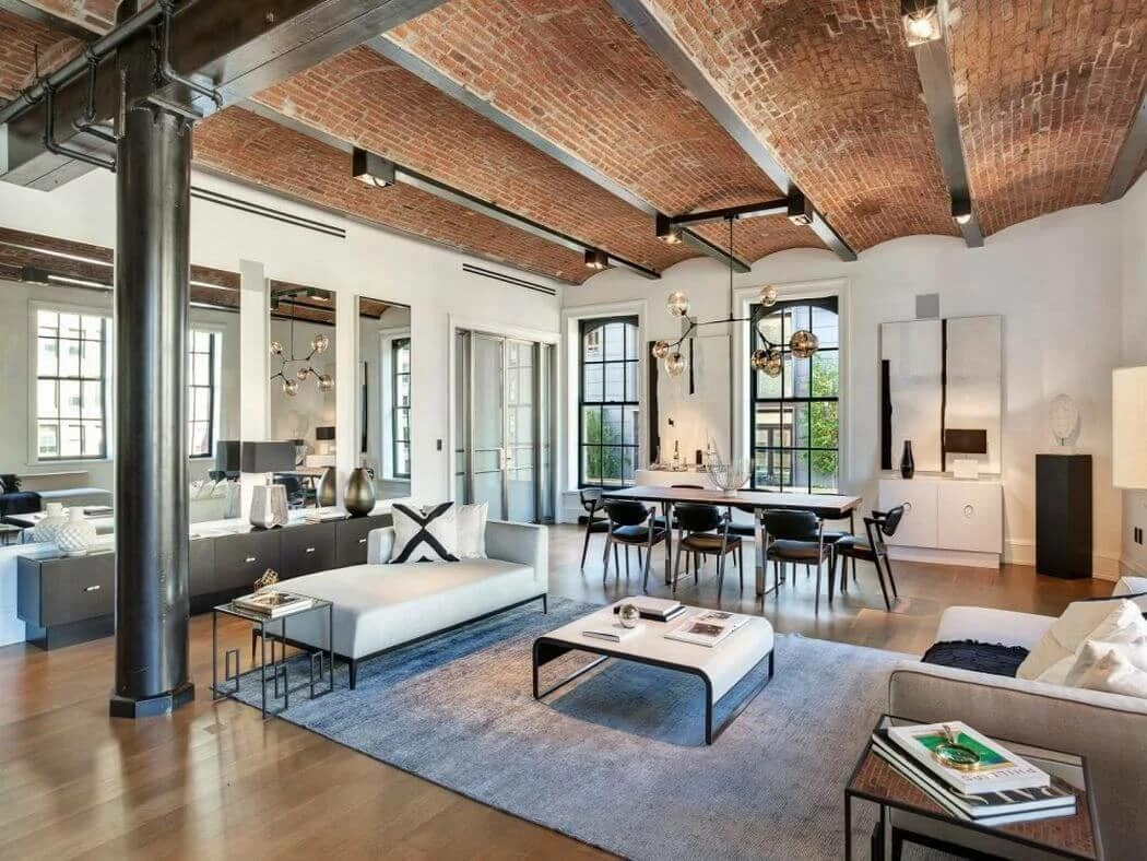 Nice wooden ceiling, white walls and laminate for large open space apartment