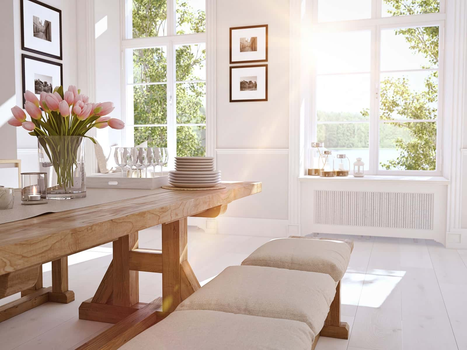 6 Beautiful Ways To Decorate Your House With Flowers. Large sunny dining room with large wooden table and a bench with pillows