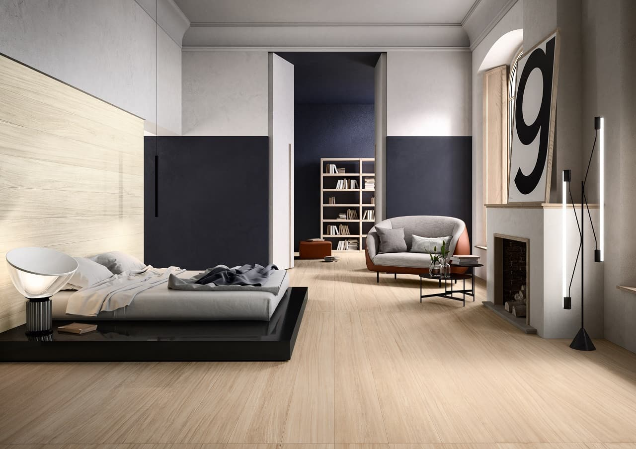 Why Consider Wood Look Tile for Your Next Home Project? Ascetic minimalism in the bedroom with a platform bed and artificial fireplace