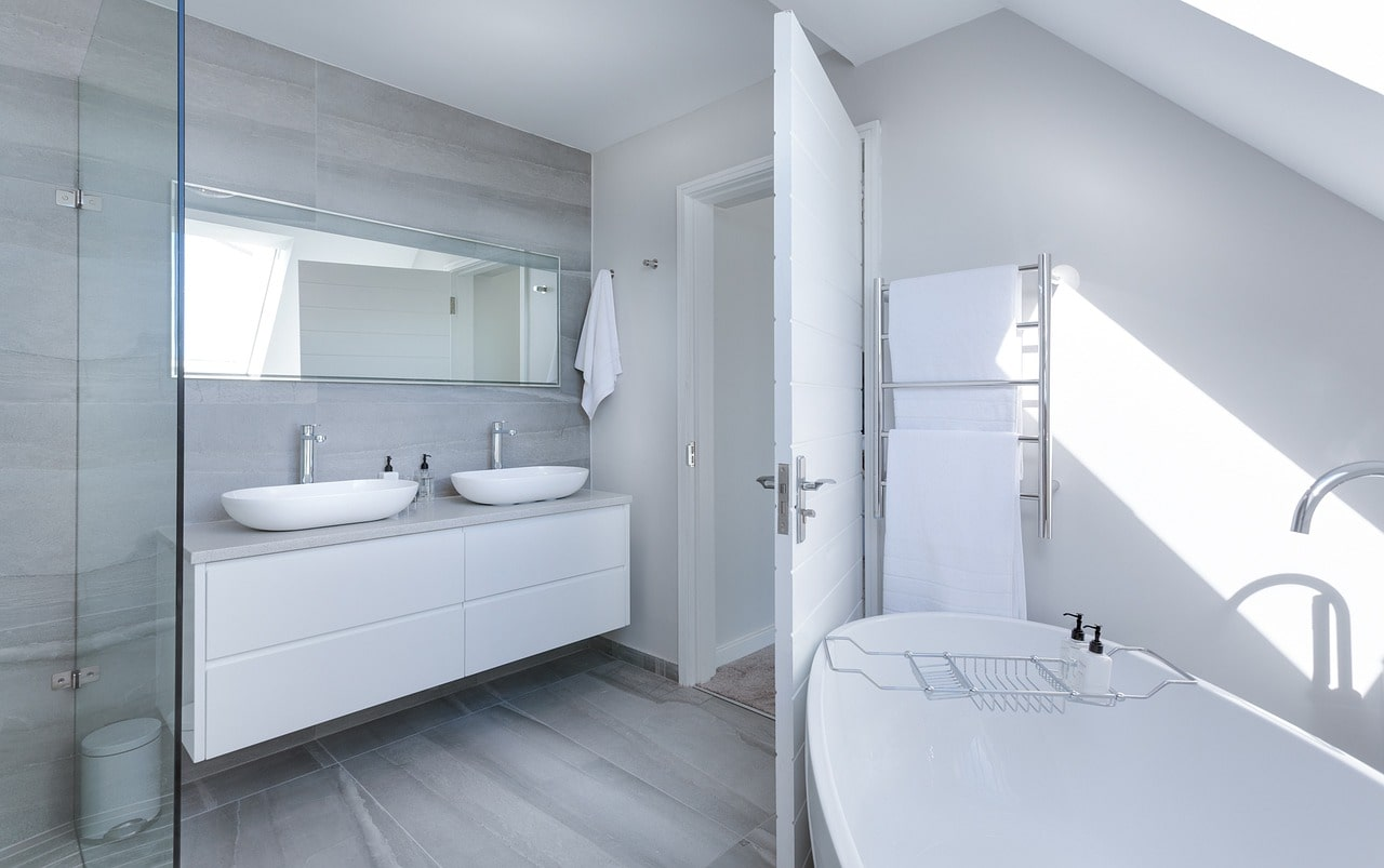 5 Bathroom Remodeling Trends to Consider. Large master bathroom with skylight, wide rectangular mirror, and egshell tub