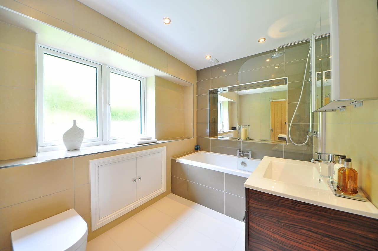 5 Bathroom Remodeling Trends to Consider. Warm color palette with mild peach color and gray accent bathtub wall