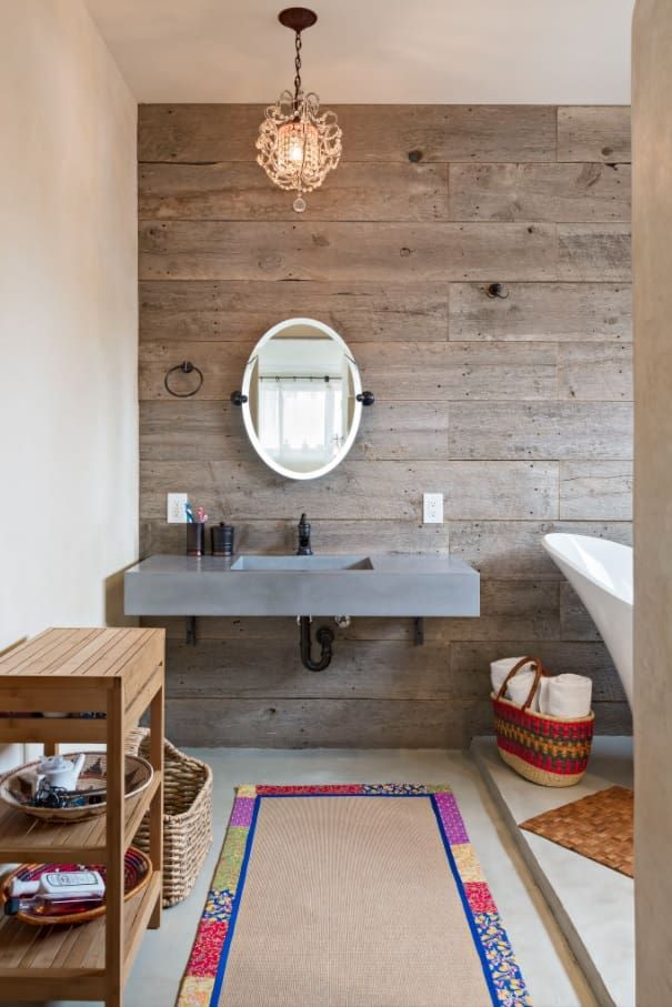 From Basic to Fancy: How to Upgrade Your Bathroom with New Trending Décor Ideas. Classy wooden trimming of the wall with round mirror