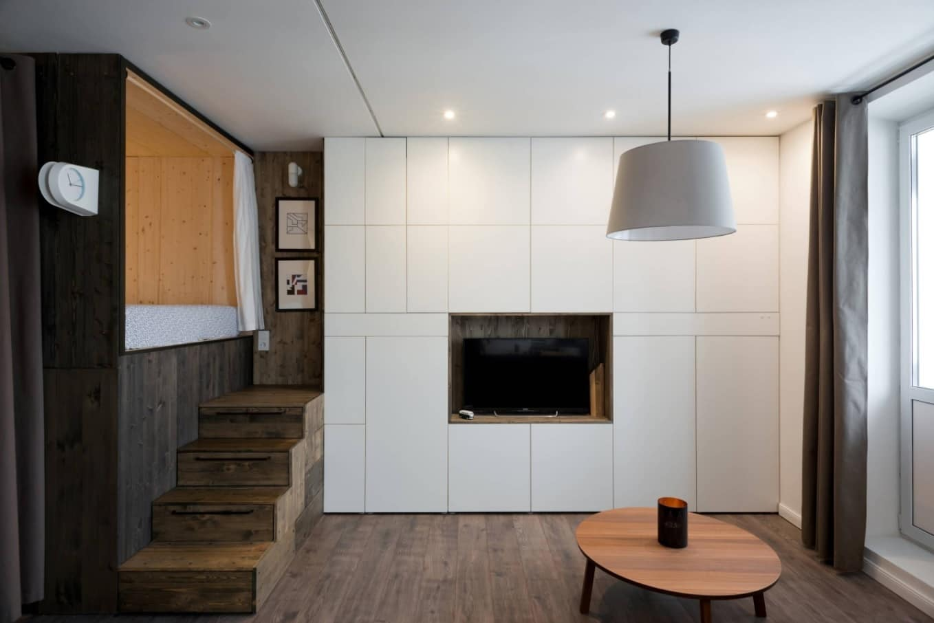 5 Steps to DIY Designing on a Budget. White matted panels on the accent wall to create monolithic look and the place for an artificial fireplace