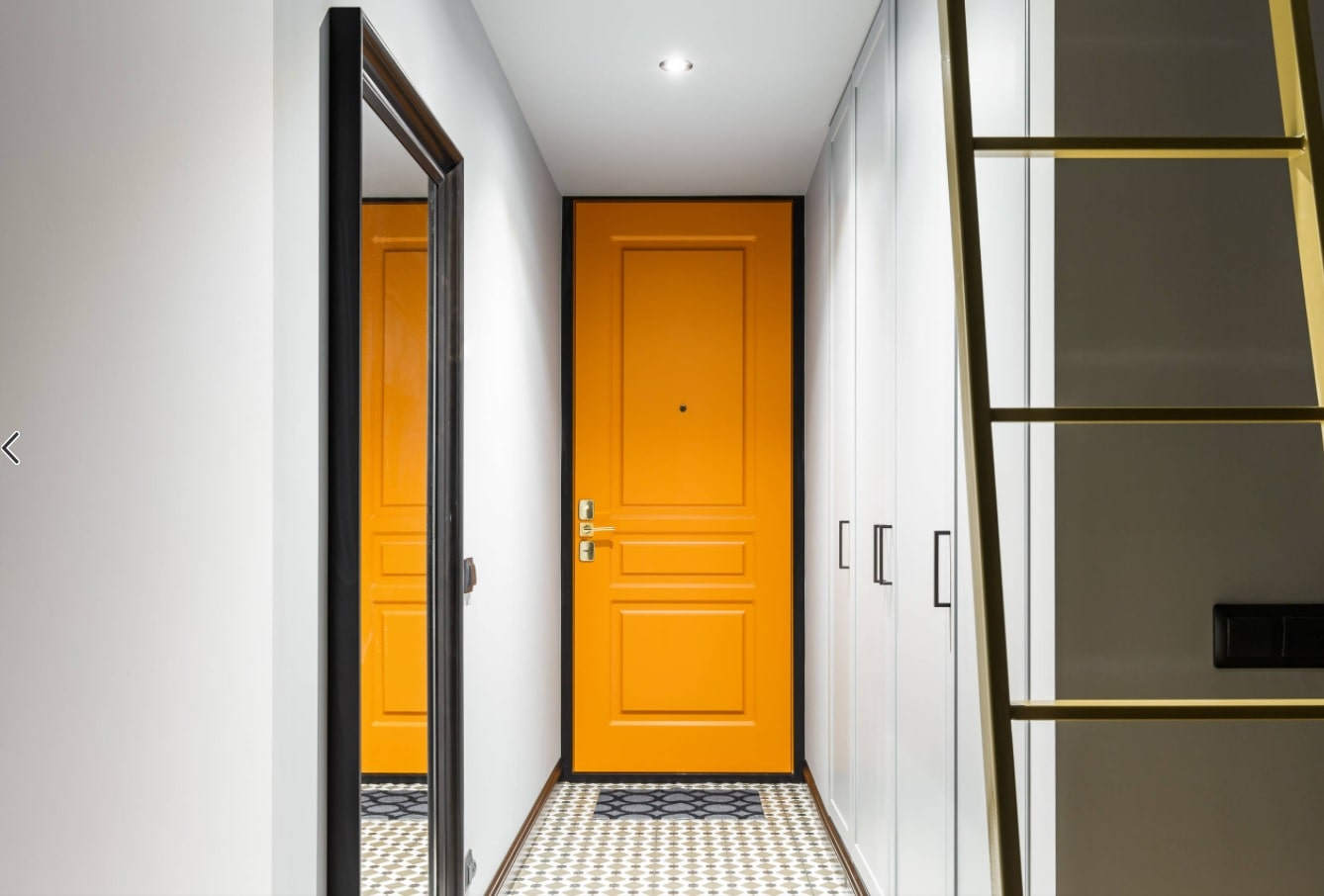 5 Steps to DIY Designing on a Budget. Garish yellow entrance door to revive white hallway's interior