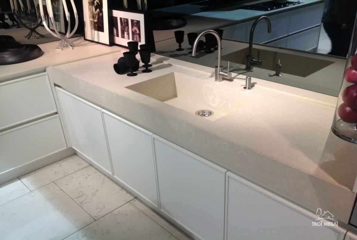 Laminate vs. Quartz Countertops: What is the Price Difference. Matt gray quartz countertop and dark glass splashback