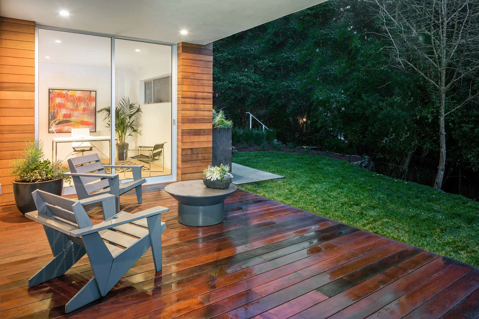 9 Ways To Liven Up Your Patio. Dark lacquered patio deck with gray wooden chairs and a small round table