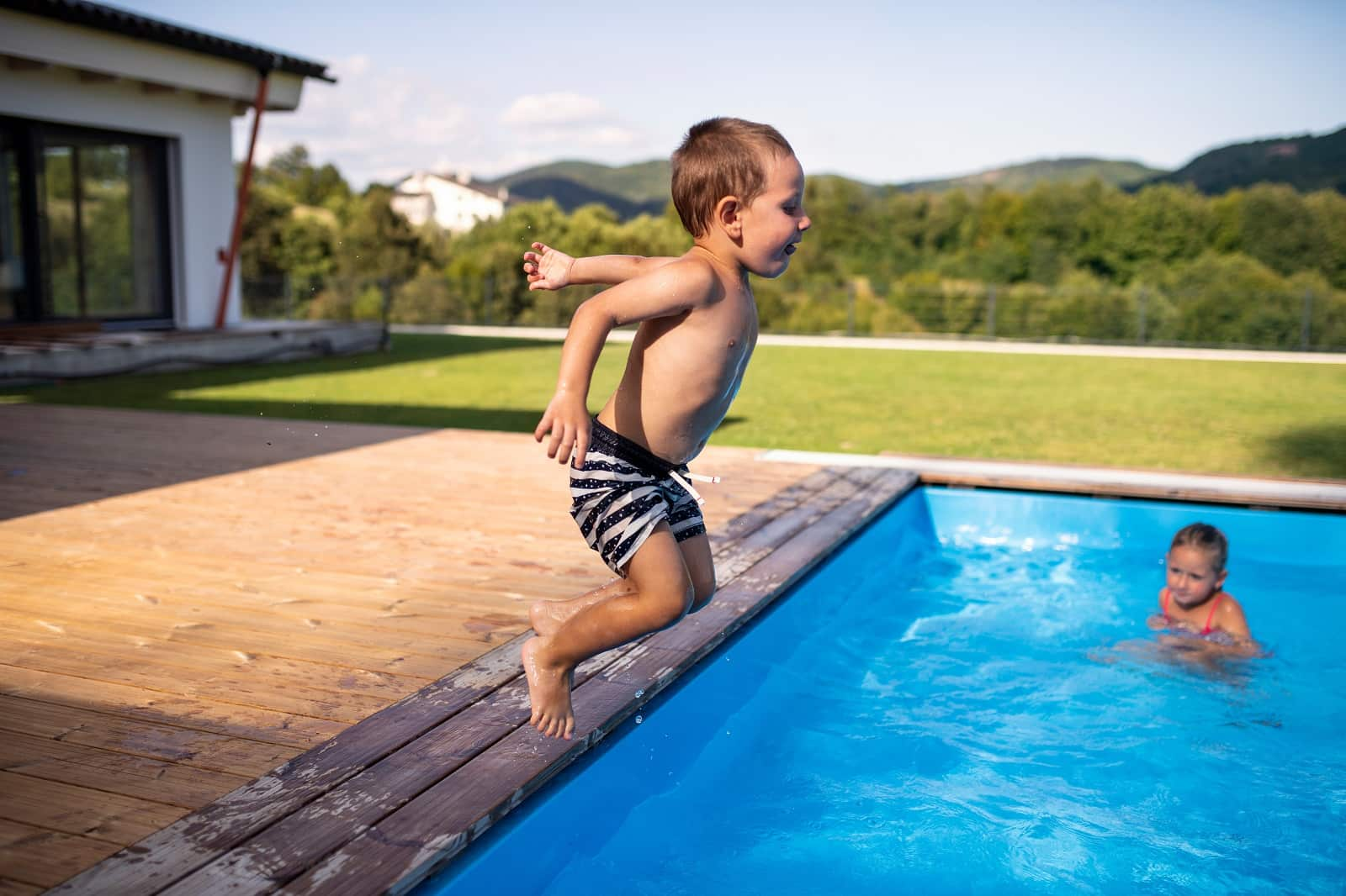 6 Pool Design Tips If You Have A Small Backyard. The boy jumping into the pool