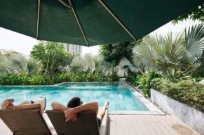 6 Pool Design Tips If You Have A Small Backyard. Summer chilling under the large green beach umbrella