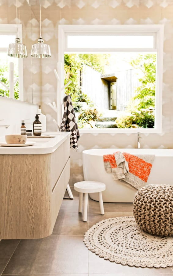 Top Reasons to Invest in a New Bathroom. Mild color palette and natural materials along with plant decoration
