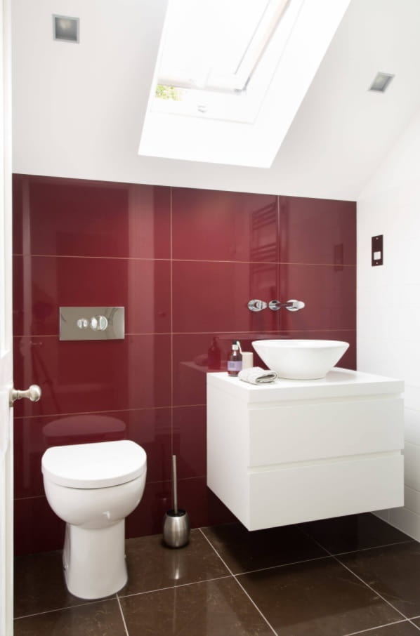 Top Reasons to Invest in a New Bathroom. Glossy red tile and white hovering vanity for emphasizing of modern style