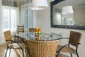 Tempered Glass Round Table Top with a Feeling of Luxury Home Interior Settings. Rattan weaved furniture for casual styled dining