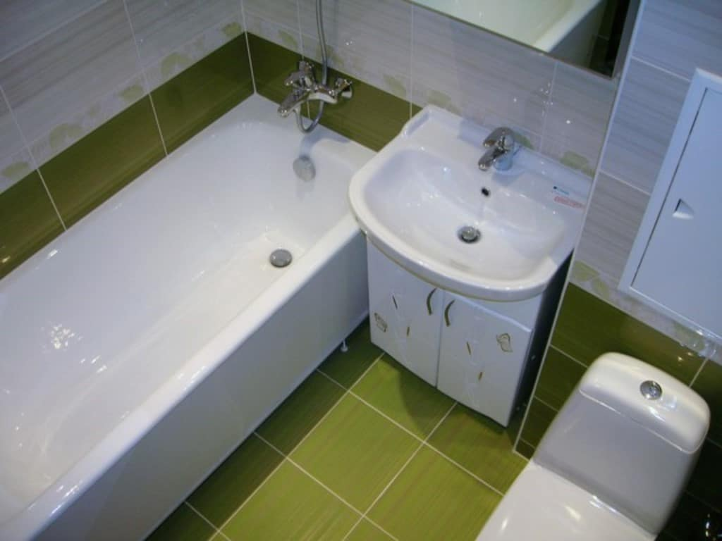 7 Worst Things You Can Do During a Bathroom Remodel Project. Green and white color palette for the small room full of appliances