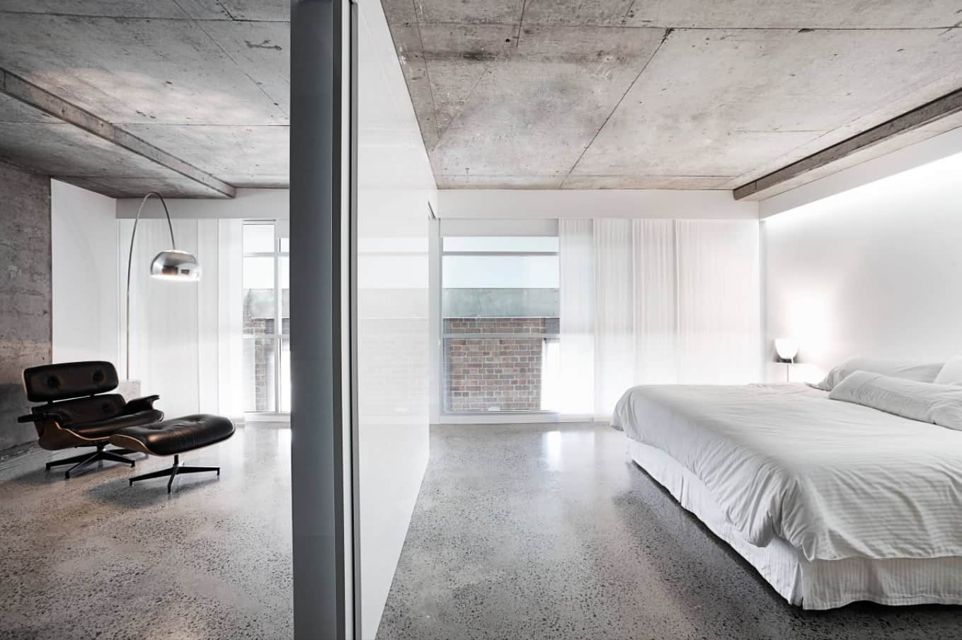 Reasons Why Concrete is the Best Flooring Alternative to Your Homes. Great minimalistic interior with shining polished concrete floor and large bed