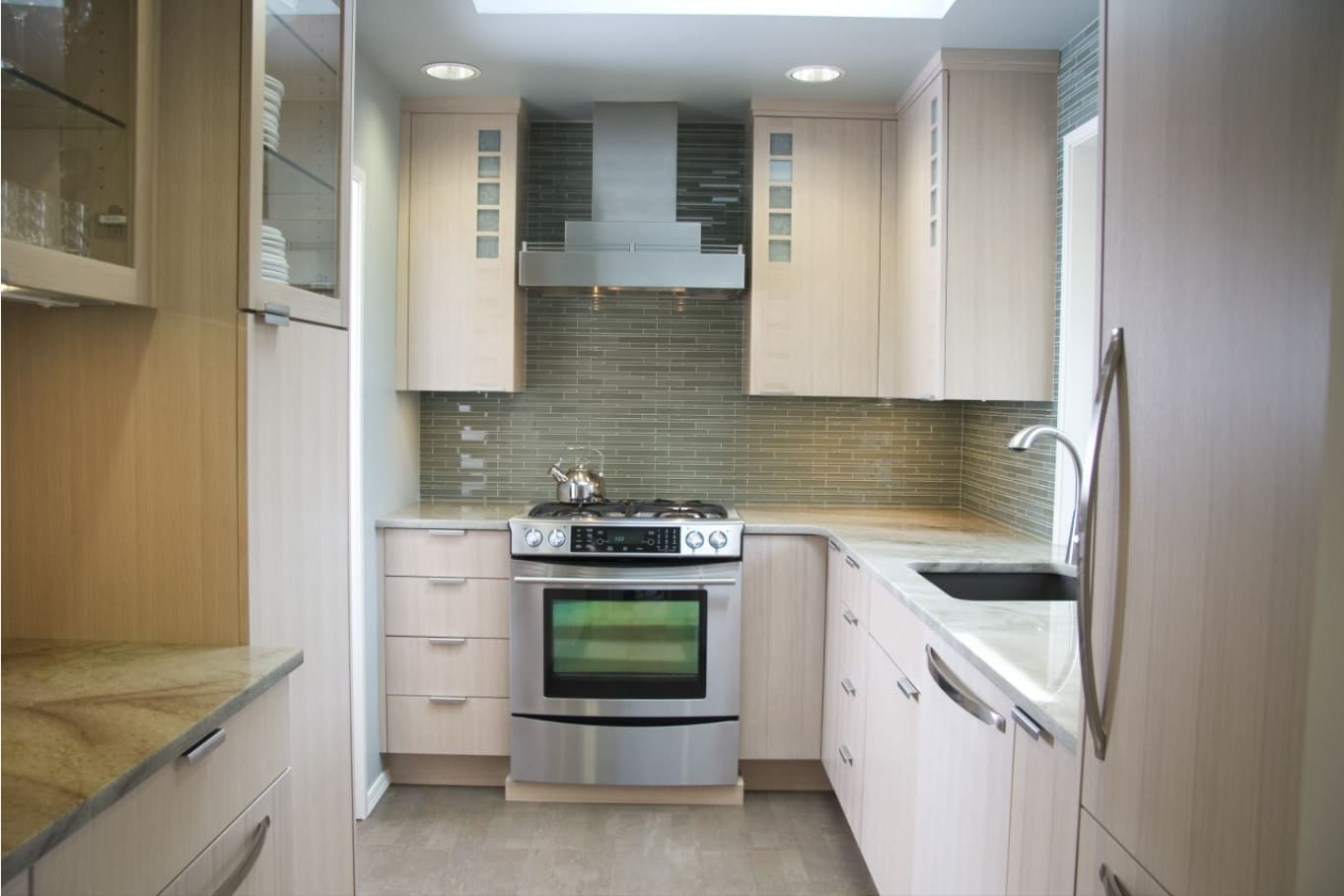 How to Make Your Kitchen Look more Expensive. Small functional space with light wooden furniture facades and same color floor