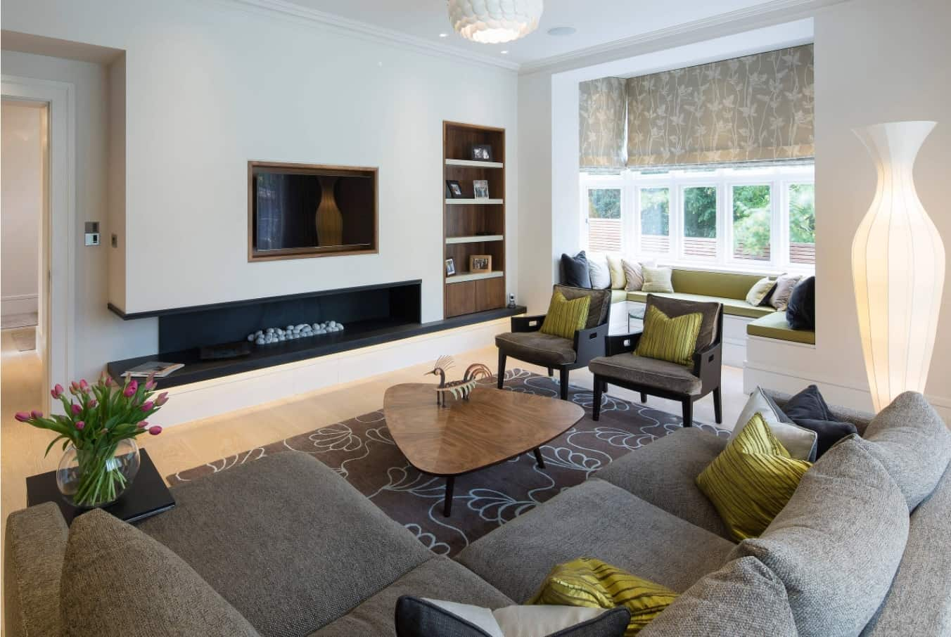 The Best Tips for Living Room Decoration. Contemporary living with built-in fireplace, bookshelf, abundance of low-key furniture