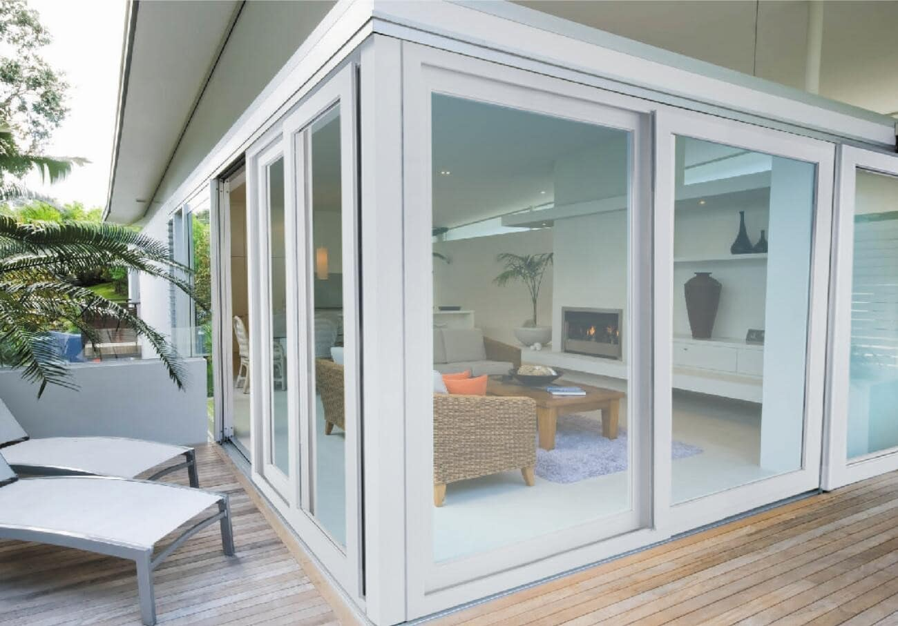 What are the Benefits of UPVC Windows and Doors? Glazed summer house with wooden deck around the perimeter