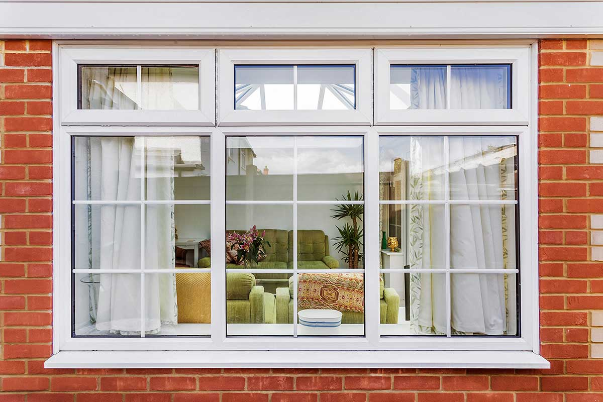 What are the Benefits of UPVC Windows and Doors? Classic design of English styled house with sash window