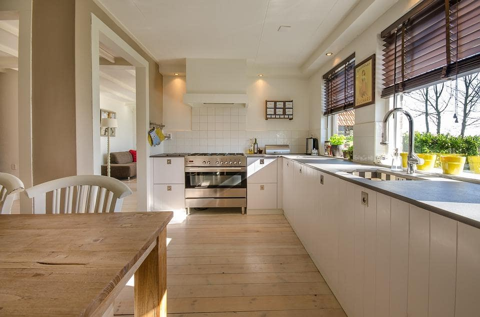 Planning To Build Your Perfect Home? Here's Some Important Advice. Mild beige, brown, and wooden tints in the casual styuled kitchen with long countertop at the windows