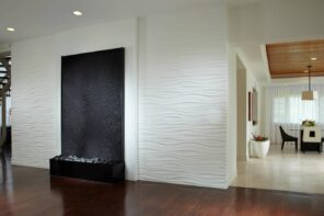 Planning To Build Your Perfect Home? Here's Some Important Advice. Light structured panels at the living zone around the artificial fireplace and dark wooden laminated floor