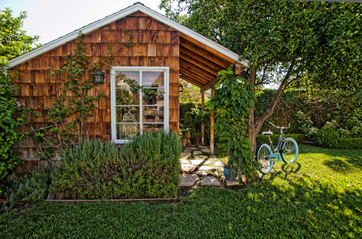 The Best Way to Clean Your Garden Shed. Colorful picture of the outdoor shed with planked facade and gable roof
