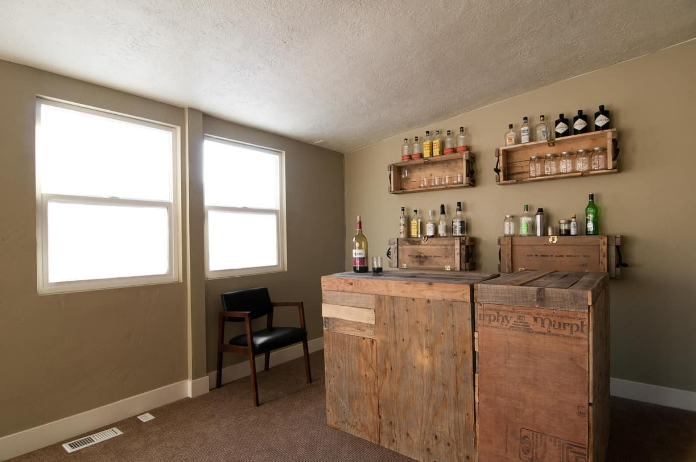 How To Create the Home Bar of Your Dreams. Barn style in the small simple decorated interior with planked furniture