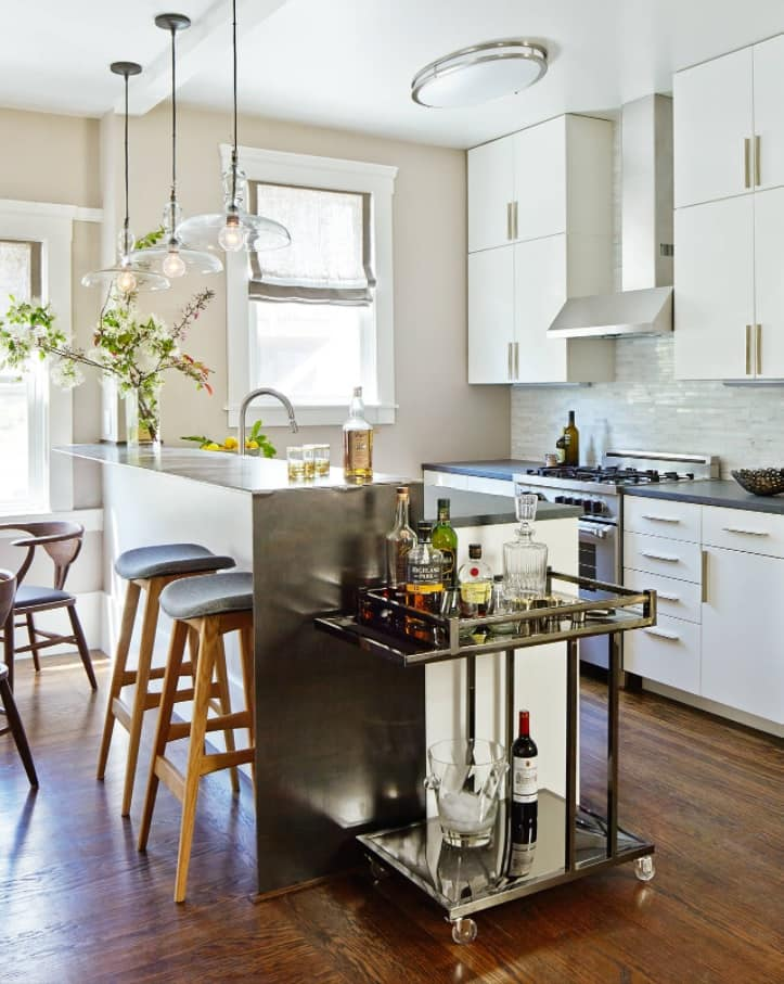 How To Create the Home Bar of Your Dreams. Metal side table to organize an extra functional space for parties in amazing fusion styled kitchen