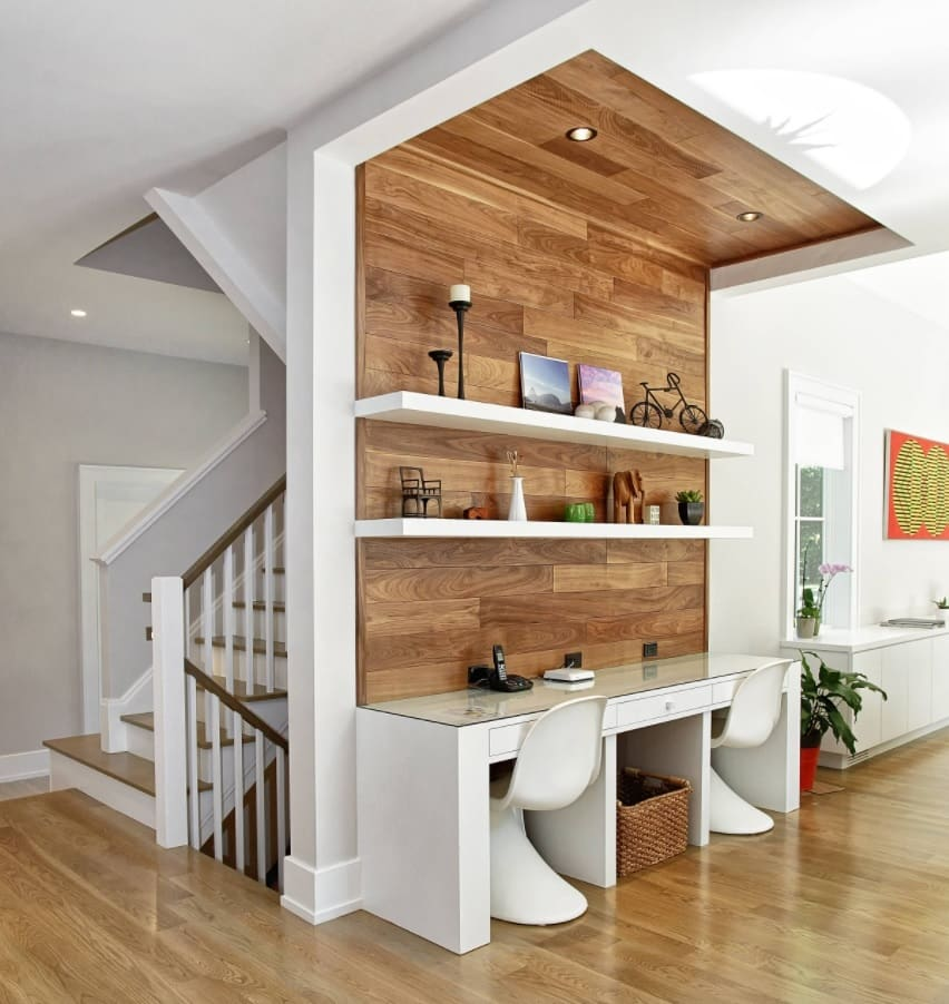 10 Ways to Give a Facelift to Your Home Office. Wooden finishing of contemporary styled space near the staircase in white