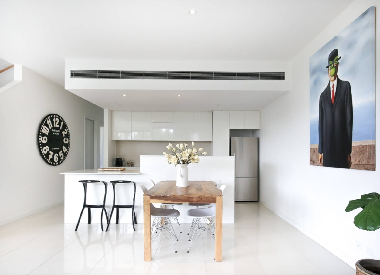 HVAC Systems: How Long Does HVAC System Last? Marvelous modern kitchen design in glossy white with built-in appliances and wooden table