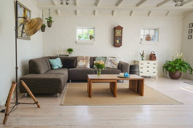 Understanding the Importance of Home Decor. Simple casual interior decoration in the living room with white walls and corner sofa