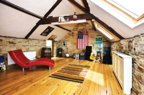 How to Turn a Long-Neglected Loft into a Music Room. Nice looking bright chalet attic with natural hardwood floor and red chaise lounge