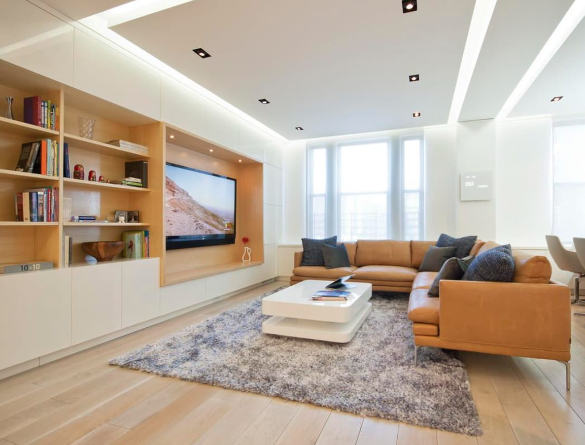 Modern Smart Home Design with Surveillance Cameras. Casual living room style with LED perimtere lighting and wooden shelving at the accent wall