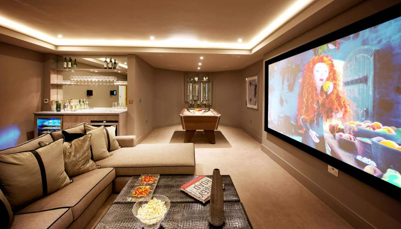 Modern Smart Home Design with Surveillance Cameras. Beige colored leisure room with LED lighting, smart controllers and large TV-set