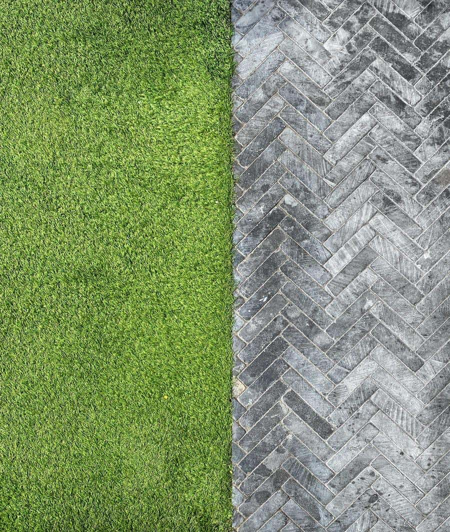 How to Strategically Use Turf Grass in Your Lawn. The border between a pathway and a lawn grass