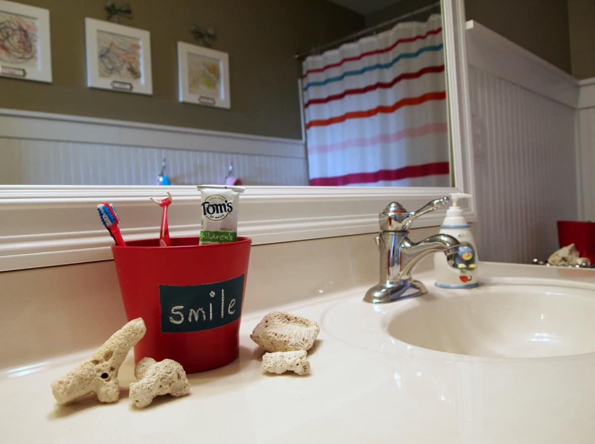 Bathroom Necessities_ 9 Things You Need to Have in Your Bathroom. Red toothbrush holder in the casual styled bathroom