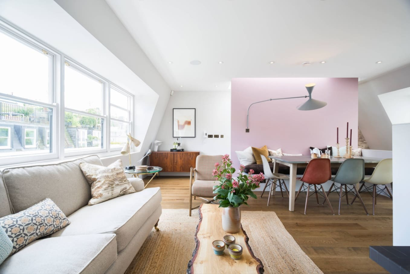 How to Spice Up Your Interior with Accent Walls. Bright pink accent among totally white contemporary living room interior with log table